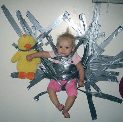 ABL-baby-taped-to-wall2.jpg